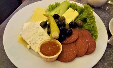 "My breakfast called ""Tausend und eine Nacht"" with olives, sheep cheese, some other sorts of cheese, salami, butter, marmalade, sweet pepper, cucumber, and salad"
